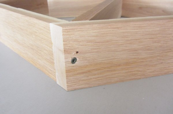 Drill a pilot hole into the middle shelf