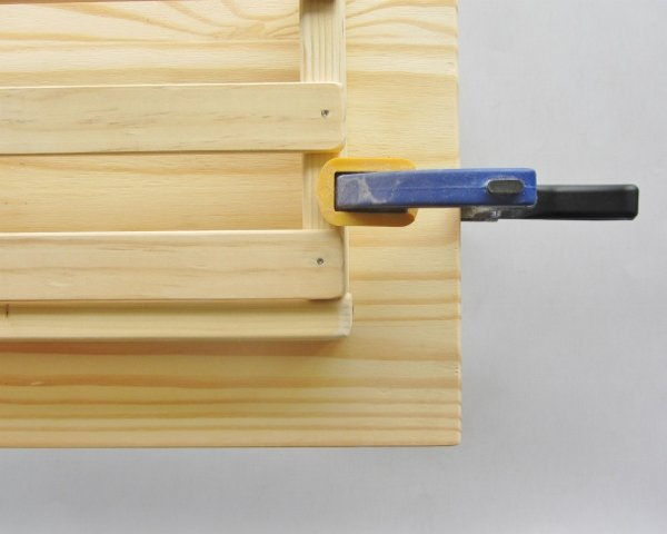 Clamp each side of the box to the board