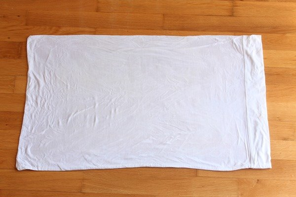 Lay the pillow case flat