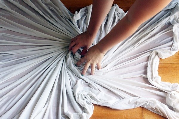 Use both hands to twist the sheet