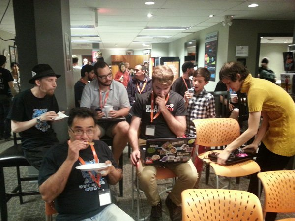 People eating at a game jam