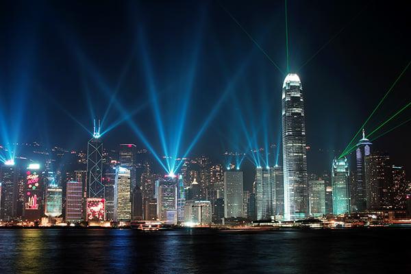 Hong Kong light show viewed from the water at night