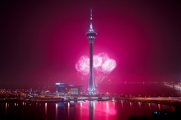 Fireworks at night over a bay