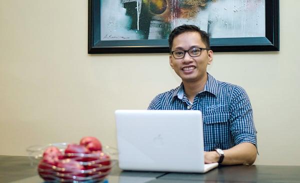 Web developer Andrew Garcia with his laptop