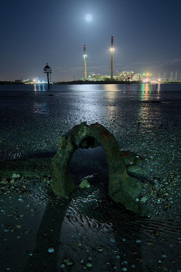 Industrial beach at night