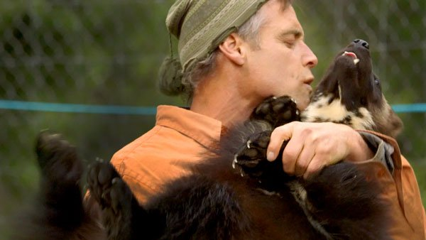 Man holding a dog