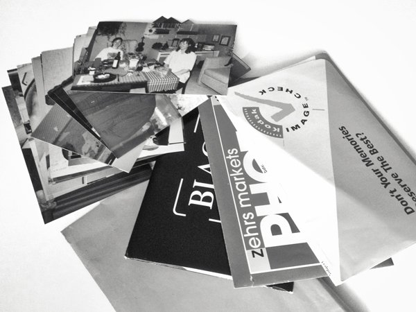 A pile of photographs loose and in envelopes