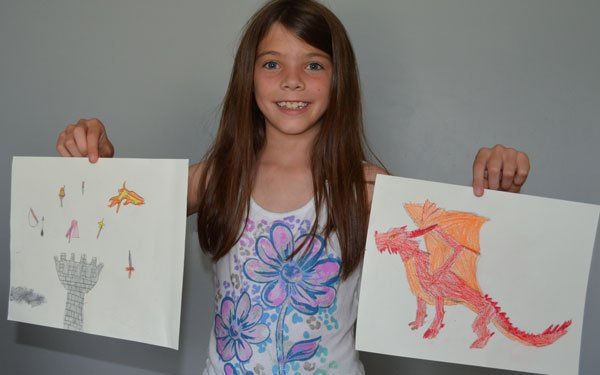 Kirks daughter holding up her drawings for the Fantasy Me tutorial
