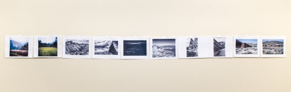 A sequence of photos on a wall
