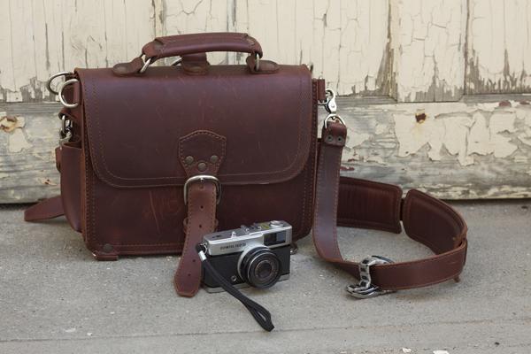 Leather satchel and rangefinder camera