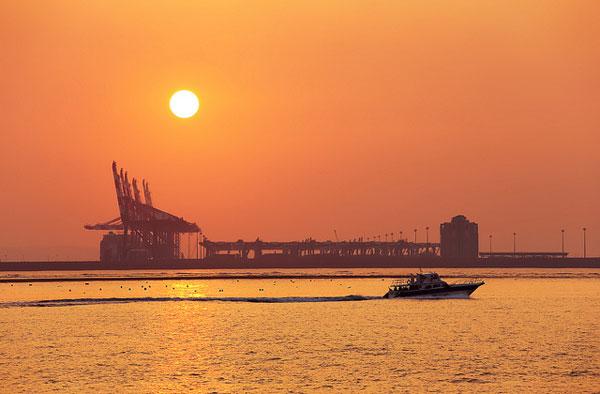 Orange sunset over a seaport