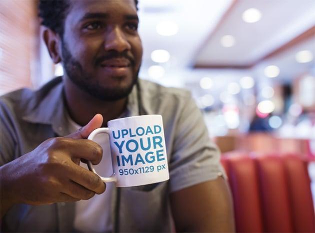 Mug Mockup of a Young Man at a Diner