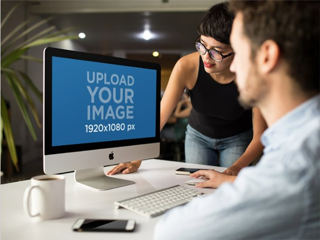 Girl Showing Something in iMac Mockup to Coworker