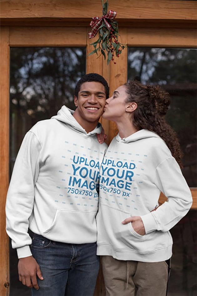 Hoodie Mockup Featuring a Couple Kissing Under Mistletoe