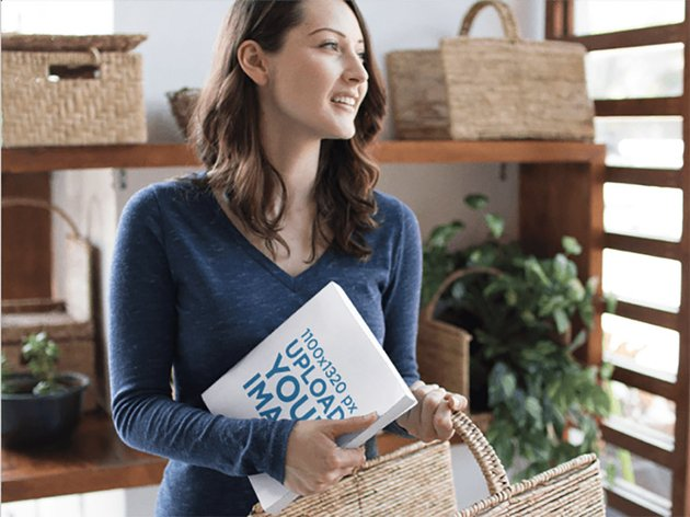 Pretty Woman Holding a Book and a Basket Mockup