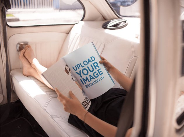 Mockup of a Young Woman Reading a Magazine While Relaxing in the Back of a Car