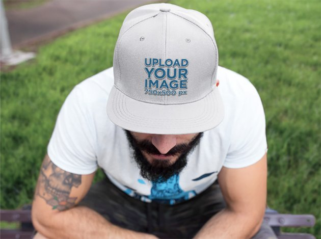 Embroidered Hat Mockup of a Guy Sitting in a Park