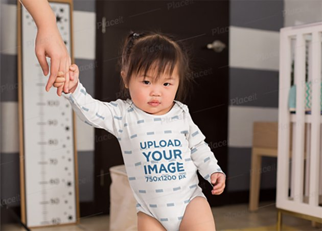 Onesie Mockup of a Baby Girl Holding Her Moms Hand