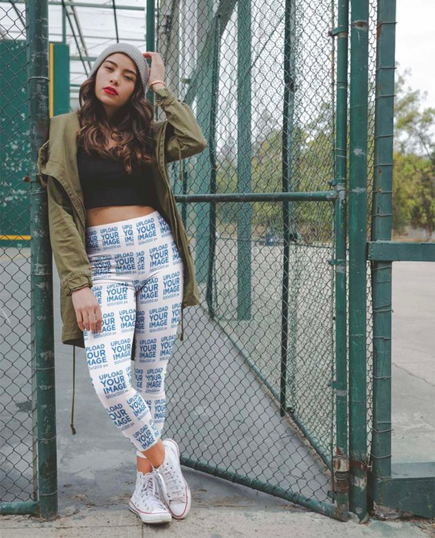 Mockup of a Trendy Woman Wearing Womens Running Leggings at a Basketball Court Entrance