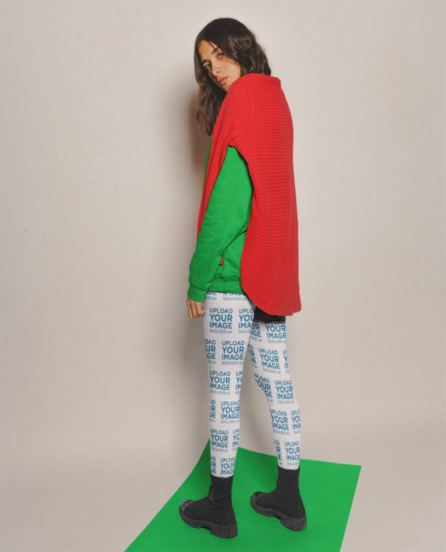 Mockup of a Woman Wearing Leggings Standing on a Pasteboard