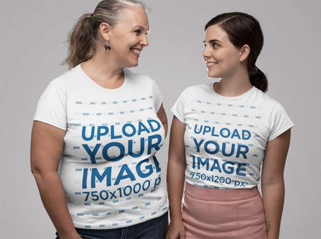 Mockup of Mother and Daughter Wearing a T-Shirt and Looking at Each Other