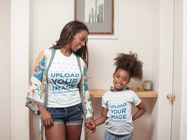 T-Shirt Mockup of a Happy Girl at Home with her Mom
