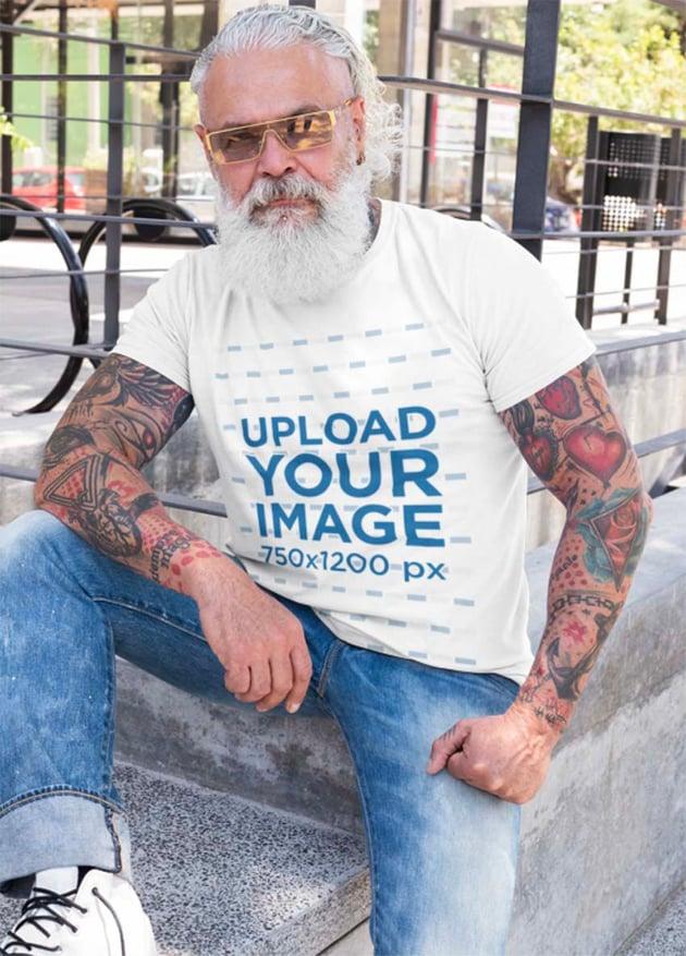 T-Shirt Mockup of a Senior Tattooed Man with Sunglasses