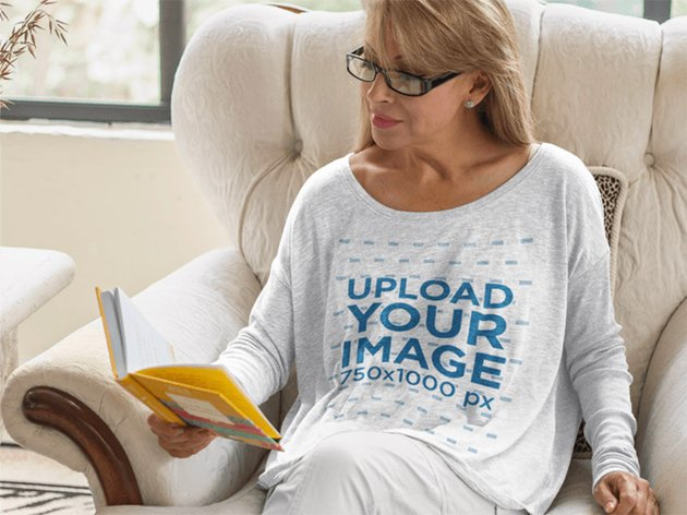 Long Sleeve T-Shirt Mockup of a Woman Reading at Home