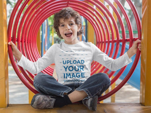 Long Sleeve Tee Mockup of a Boy Playing on a Playground