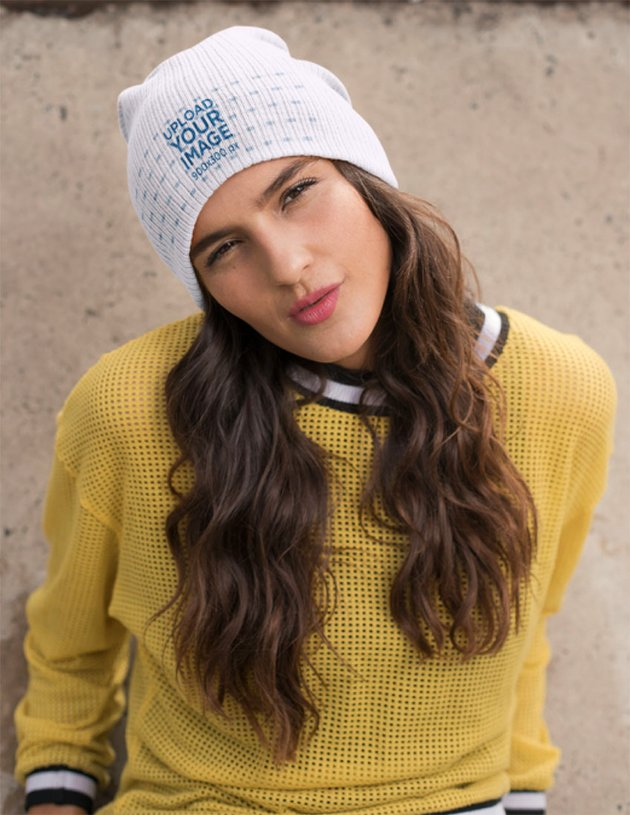 Beanie Mockup Featuring a Young Woman Wearing a Yellow Sweater