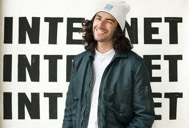 Mockup of a Man Wearing a Knit Beanie and Winking