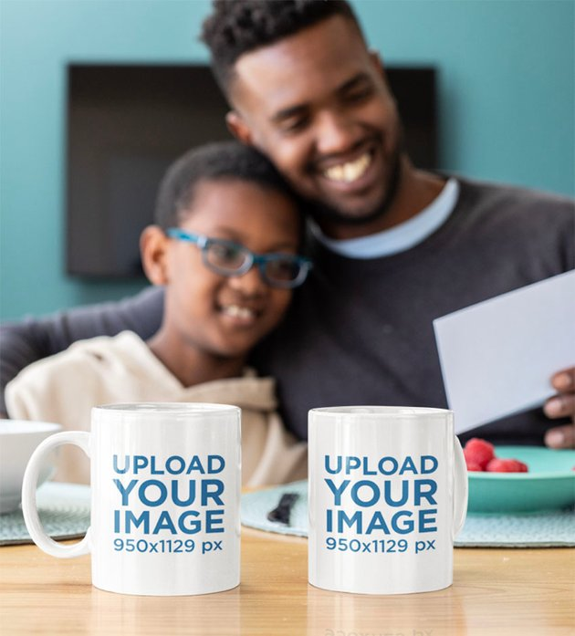 Mockup of Two Mugs Placed in Front of a Dad and His Son