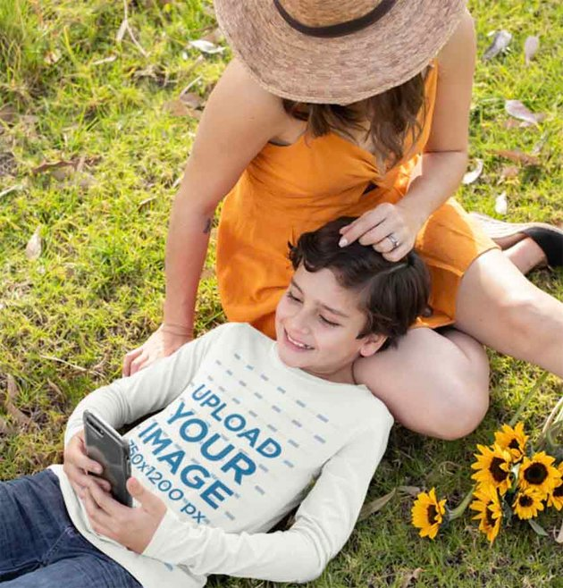 Long Sleeve Shirt Mockup of a Boy Lying Down on the Grass with His Mom