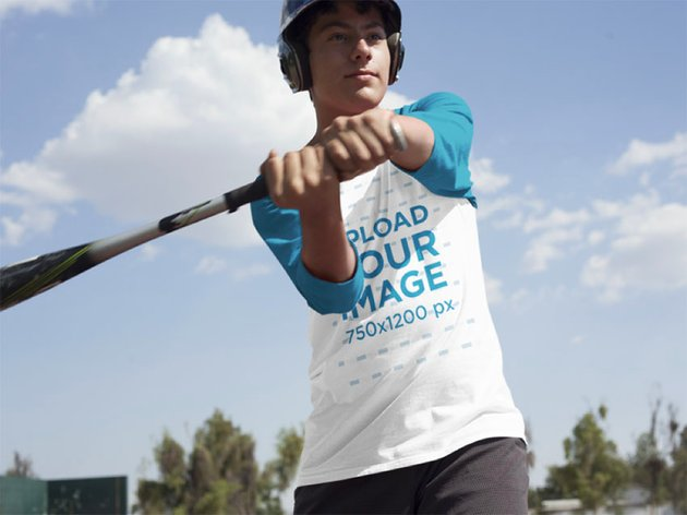 Boy in Sublimation Shirt About to Hit the Ball