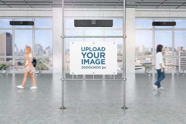 Mockup of a Horizontal Poster Mockup in a Public Corridor