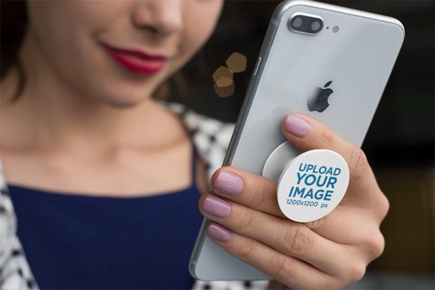 Blank Phone Grip Mockup of a Woman Smiling at Her Phone