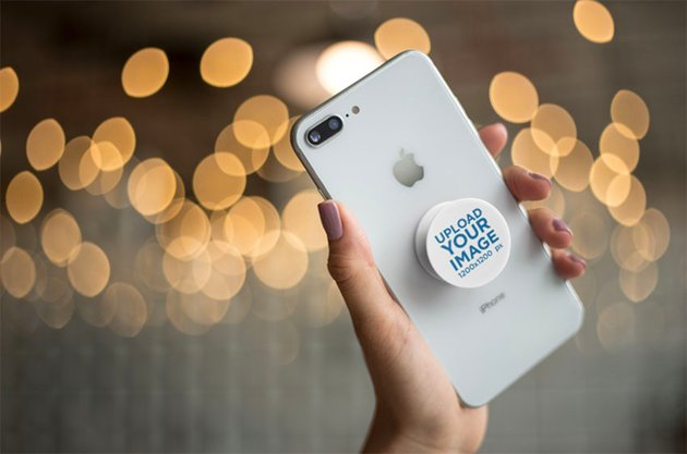 Mockup of a Blank Phone Grip with Twinkle Lights in the Background
