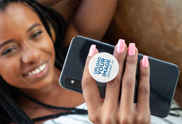 Phone Grip Mockup Featuring a Woman Lying on a Couch