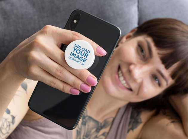 Blank Phone Grip Mockup of a Woman Looking at Her Phone