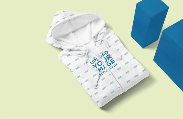 Mockup of a Folded Sublimated Hoodie by Some Blocks