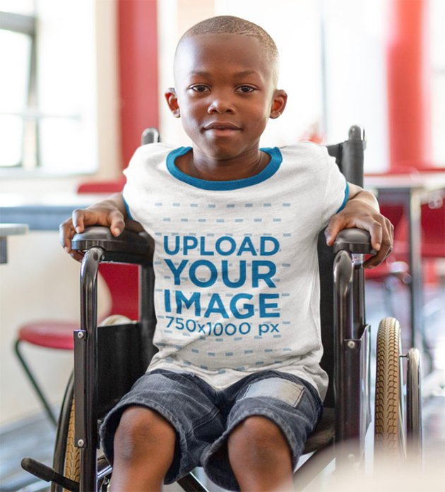 Child Shirt Mockup with a Kid Using a Wheelchair