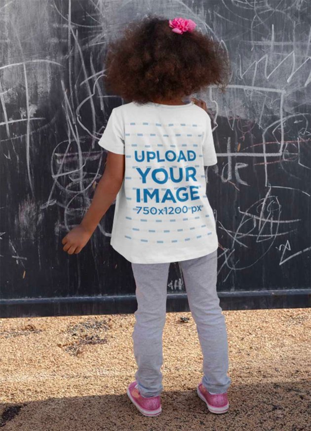 Back-View Kids T-Shirt Mockup of a Girl Drawing on a Wall