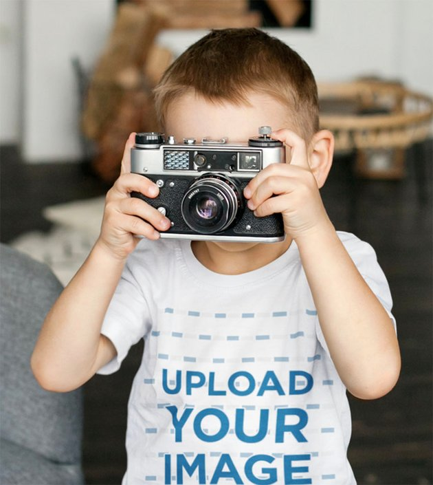 T-Shirt Kid Mockup of a Boy Taking a Picture With an Old Camera