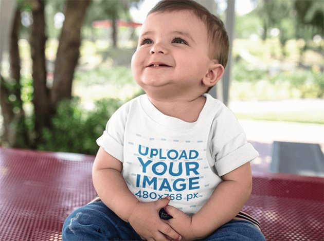 Baby T-Shirt Mockup with Boy Looking up While Smiling
