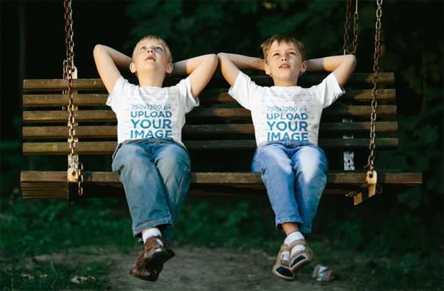 Child T-Shirt Mockup Featuring Two Brothers on a Swinging Bench