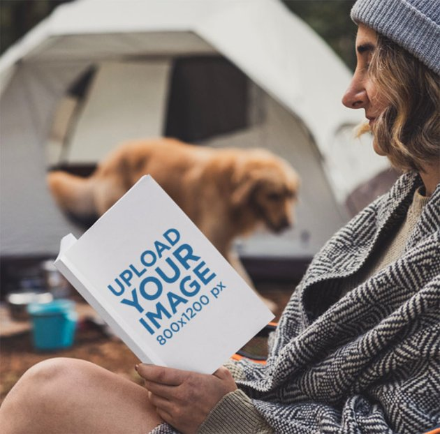 Book Mockup Generator of a Young Woman Camping with Her Dog