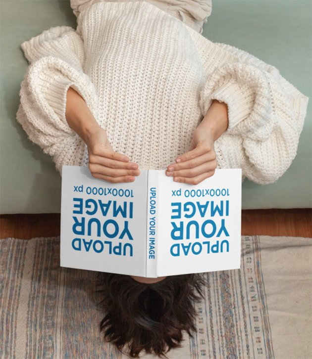 Square Hardcover Book Mockup with a Woman Reading Upside Down