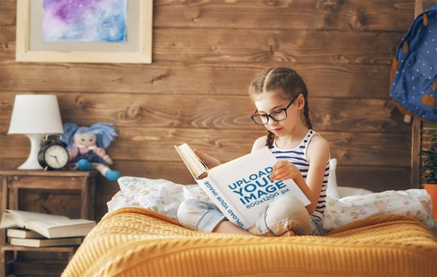 Book Cover Mockup of a Little Girl Reading a Book in Bed