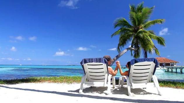 Romantic Couple Resting on Deckchairs