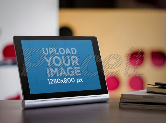 Mockup of an Android Tablet Placed in Landscape Position over a Desk